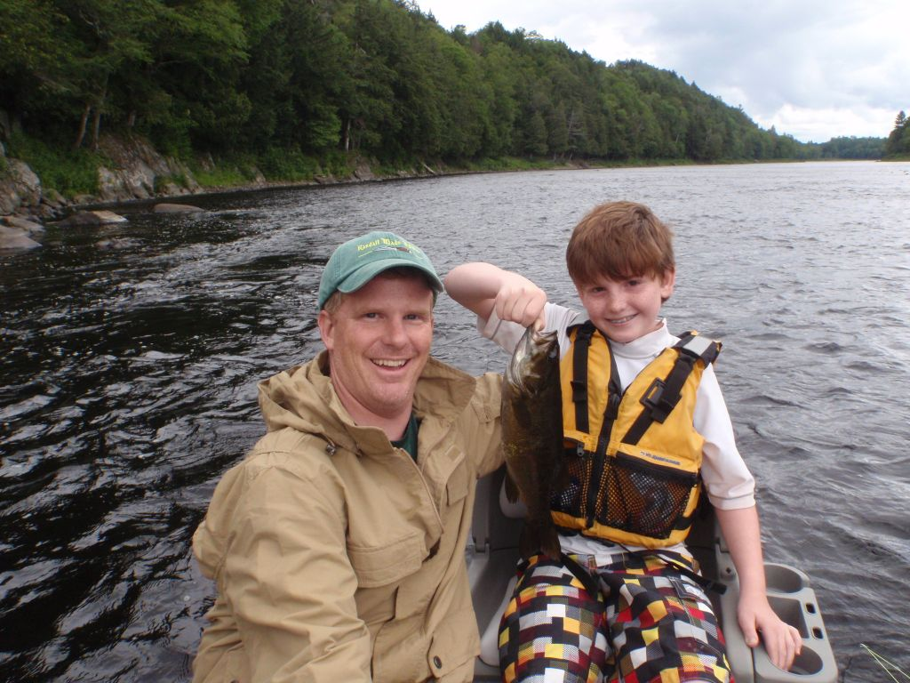 Father and young son bass fishing